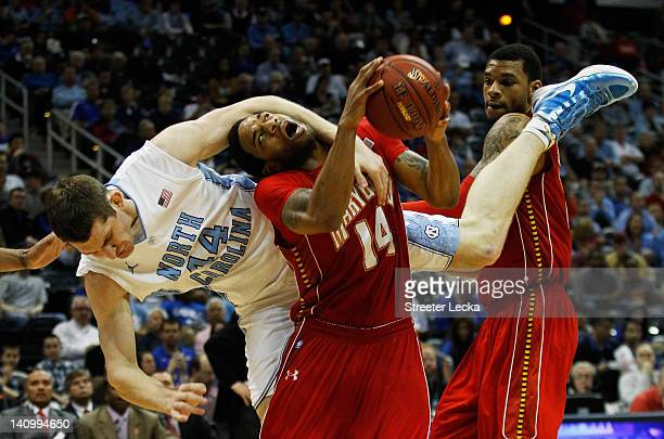 Tyler Zeller of the North Carolina Tar Heels fouls Sean Mosley of the Maryland Terrapins in the second half during the Quarterfinals of the 2012 ACC...