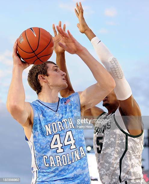 Tyler Zeller of the North Carolina Tar Heels looks to shoot over Adreian Payne of the Michigan State Spartans in the first half during the NCAA men's...