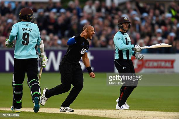 Tymal Mills of Sussex celebrates the wicket of Steven Davies of Surrey caught by team mate Matt Machan during the NatWest T20 Blast between Sussex...
