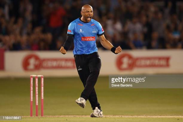 Tymal Mills of Sussex Sharks celebrates taking the wicket of Ryan Patel of Surrey during the Vitality Blast match between Sussex Sharks and Surrey at...