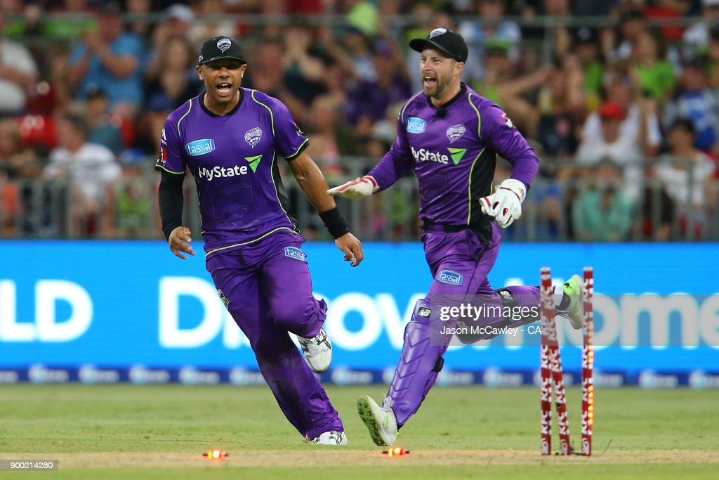 Tymal Mills of the Hurricanes and Matthew Wade celebrate the dismissal of Jos Butler of the Thunder during the Big Bash League match between the Sydney Thunder and the Hobart Hurricanes at Spotless Stadium on January 1, 2018 in Sydney, Australia.