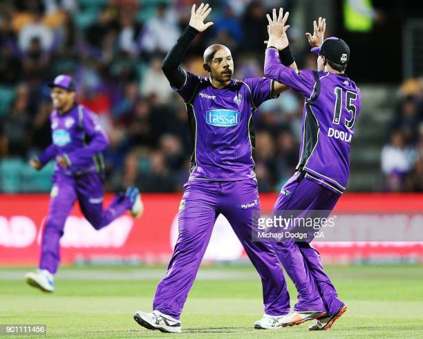 Tymal Mills of the Hurricanes celebrates the wicket of Colin Ingram of the Strikers during the Big Bash League match between the Hobart Hurricanes...