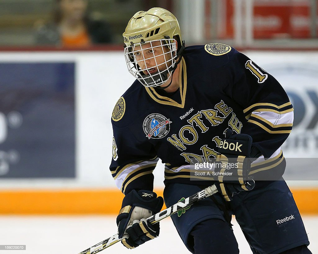 T.J. Tynan #18 of the Notre Dame Fighting Irish warms up before a game against the Minnesota Gophers January 8, 2013 at Mariucci Arena in Minneapolis, Minnesota.