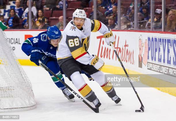 Tynan of the Vegas Golden Knights tries to fight off the check of Olli Juolevi of the Vancouver Canucks in NHL preseason action on September 17 2017...