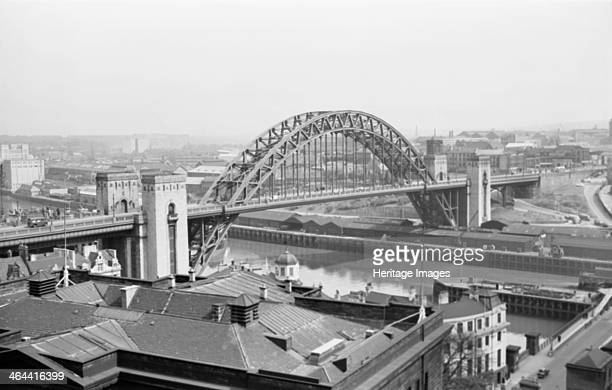 Tyne Bridge Newcastle upon Tyne Tyne and Wear 19451980 Looking across the rooftops of Newcastle to the Tyne Bridge The bridge is really called the...