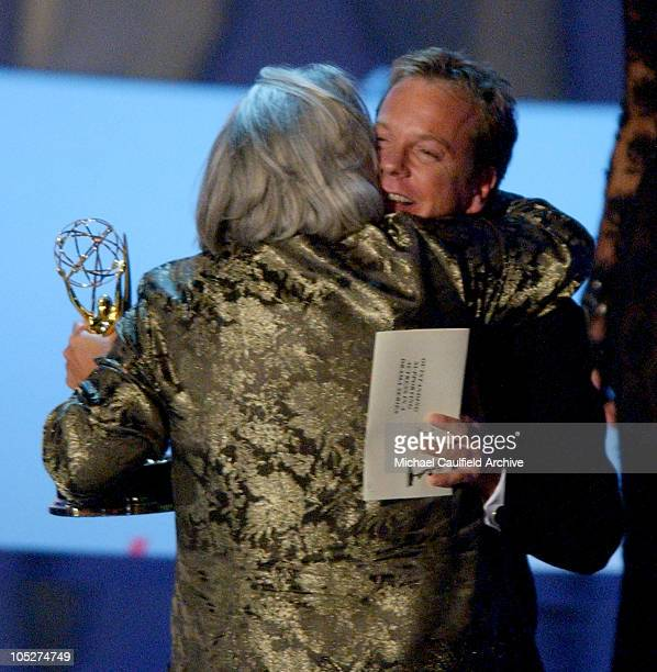 Tyne Daly winner for Best Supporting Actress in a Drama Series 'Judging Amy' receives a hug from Kiefer Sutherland