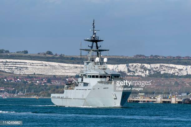 HMS Tyne departing Portsmouth Harbour to patrol the offshore fishing areas of the English Channel In the background chalk cliffs of Portsdown Hill