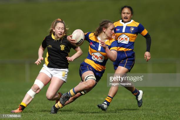 Tynealle Fitzgerald of Bay of Plenty attempts to evade Montana Heslop of Wellington during the Farah Palmer Cup match between the Wellington Pride...