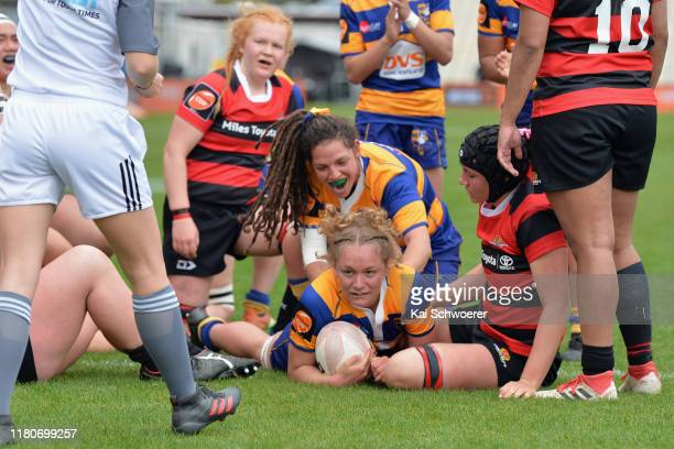 Tynealle Fitzgerald of Bay of Plenty dives over to score a try during the Farah Palmer Cup Quarter Final match between Canterbury and Bay of Plenty...