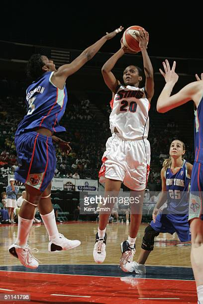 Tynesha Lewis of the Charlotte Sting shoots over Crystal Robinson of the New York Liberty during the game at the Charlotte Coliseum on July 20 2004...