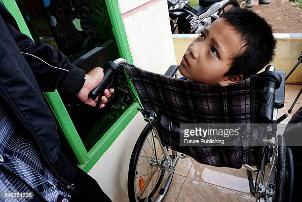 Tyo Satrio a little boy born without arms and legs seen on his wheelchair in Panawangan Ciamis on June 10 2016 in West Java Indonesia BORN without...