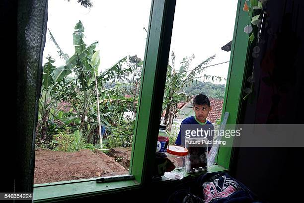 Tyo Satrio a little boy born without arms and legs seen outside his Extraordinary school Firdaus in Panawangan Ciamis on June 10 2016 in West Java...