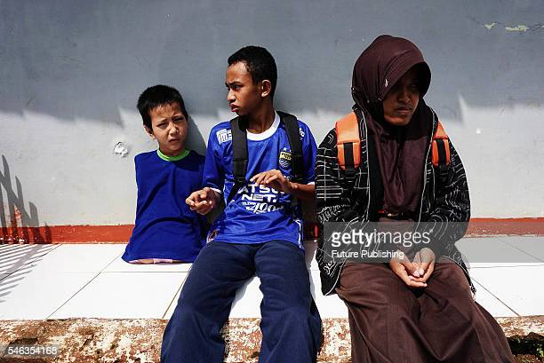Tyo Satrio a little boy born without arms and legs seen with his friends in Panawangan Ciamis on June 10 2016 in West Java Indonesia BORN without...