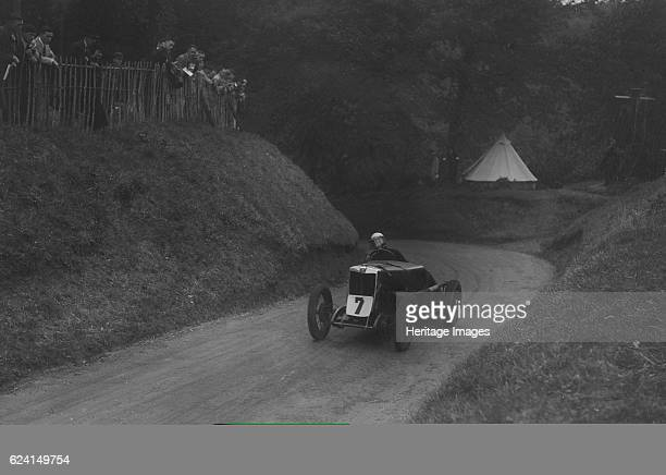 MG C type of Barbara Skinner competing in the Shelsley Walsh Hillclimb Worcestershire 1935 Artist Bill BrunellMG C 746 cc Event Entry No 7 Driver...