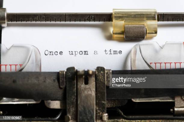 "typed sentence ""once upon a time"" written on sheet of paper in a mechanical typewriter - sentencing stock pictures, royalty-free photos & images"