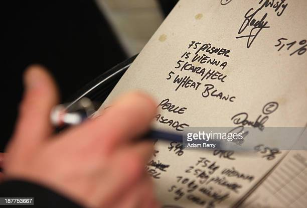Types of malted barley are seen scribbled on a piece of cardboard at Heidenpeters brewery on November 12 2013 in Berlin Germany In a country known...