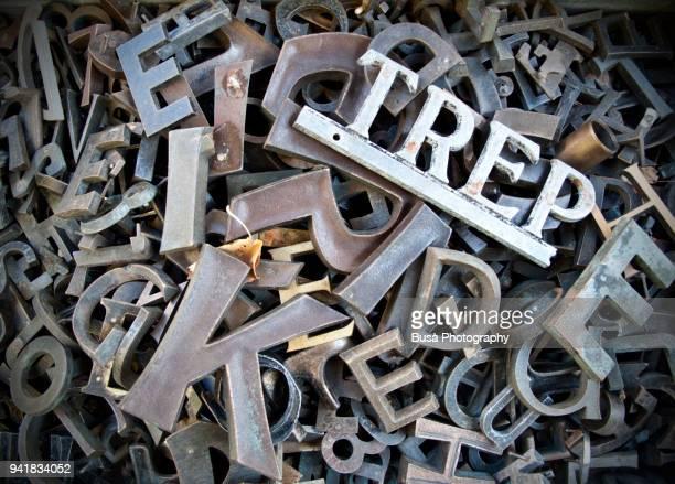 typescript metal letters seen in a flea market in berlin, germany - kunstdruck stock-fotos und bilder