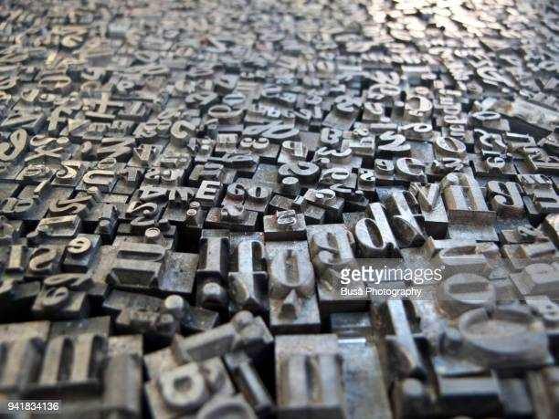 typescript metal letters seen in a flea market in berlin, germany - publisher stock pictures, royalty-free photos & images