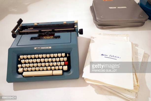 """Typewriter and a typescript of """"Adieu Voloda"""" belonged to French actress Simone Signoret, are displayed during the presentation by Digard Auction of..."""