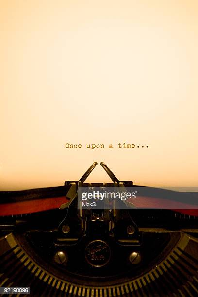 typewriter - once upon a time - authors stock photos and pictures