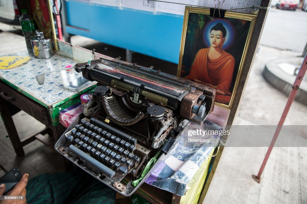 A typewriter sits in front of an image of the Buddha at a street stall in Yangon, Myanmar, on Friday, June 16, 2017. A pariah state for decades, Myanmars recent emergence from economic isolation has attracted foreign companies and investors intrigued by the Southeast Asian nations untapped potential, abundant natural resources and low wage workforce. Photograph: Taylor Weidman/Bloomberg via Getty Images