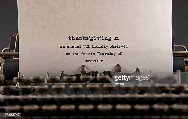 typewriter typing definition of thanksgiving on white paper - old fashioned thanksgiving stock photos and pictures
