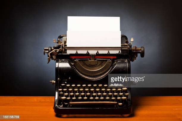 typewriter with blank sheet of paper
