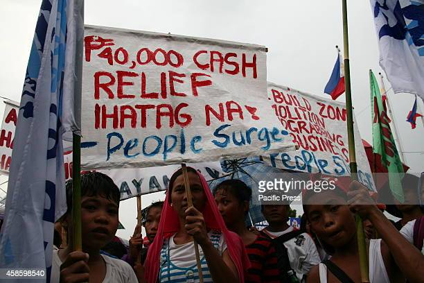 Typhoon Haiyan survivors join the march in front of Leyte province capitol.