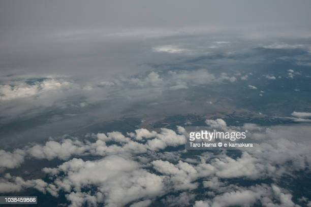 Typhoon natural disaster in Northern Luzon Island in Philippines daytime aerial view from airplane