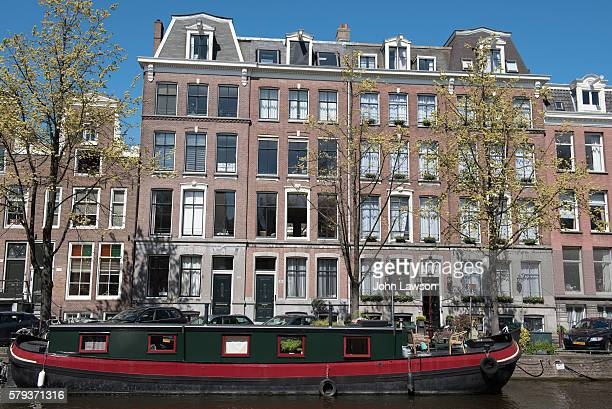 Typical Amsterdam canal houses and houseboat