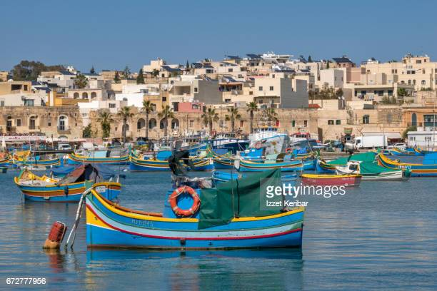 typical and colorful maltese fishing boat details at marsaxlokk harbour, southern malta - marsaxlokk stock pictures, royalty-free photos & images