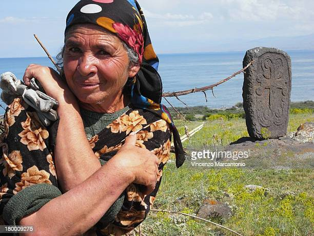 CONTENT] Typical Armenian woman devoted to sheep farming along the Sevan lake Exif_JPEG_PICTURE