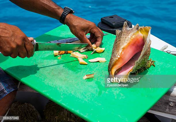 Typical bahamian local cuisine fresh seafood conch salad is prepared from fresh marine gastropod molluscs on a boat on June 15 2012 in Long Island...