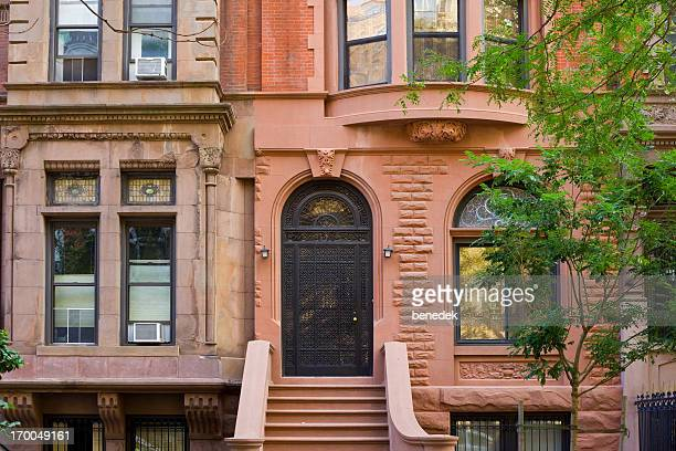 typical brownstone row house, new york city - terraced_house stock pictures, royalty-free photos & images