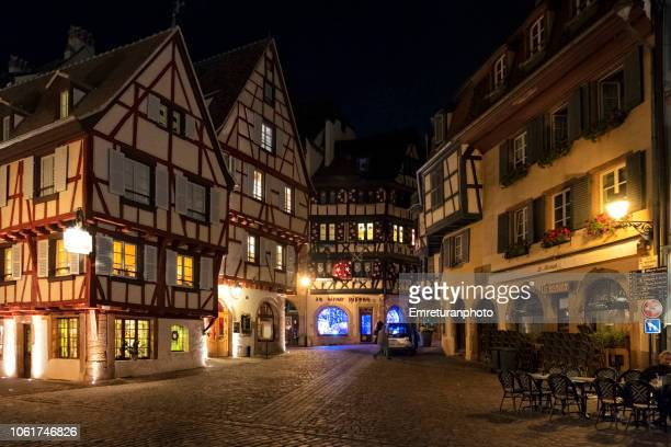 Typical buildings of little venice quarter at night in Colmar.