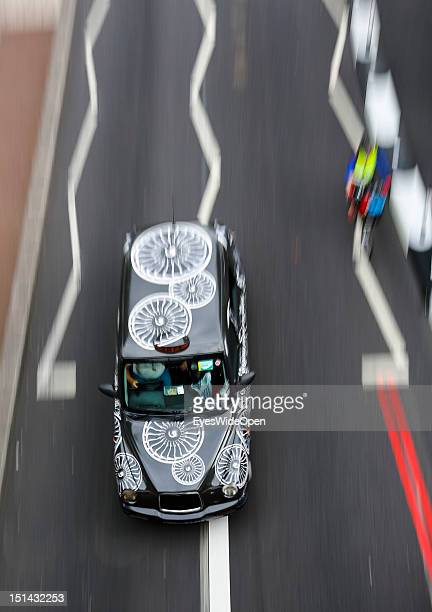 A typical cab taxi car is driving in the streets of central city on August 7 2012 in London England United Kingdom