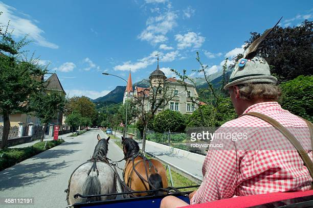 Typical carriage driver during a Fiaker tour through Innsbruck