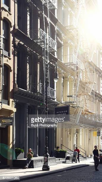Typical cast iron buildings with fire escapes along Greene Street in Soho, New York City