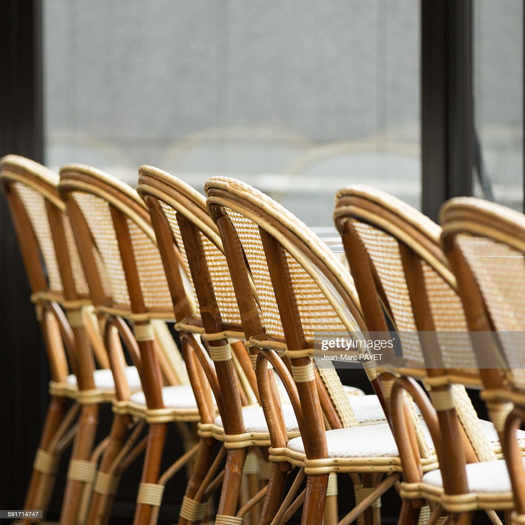 Typical chairs of a sidewalk cafe of Paris : Photo