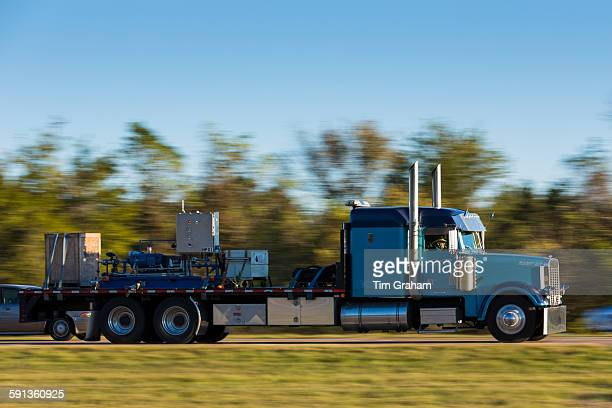 Typical clean shiny American Freightliner truck for freight transport on trucking route Interstate 10 Louisiana USA