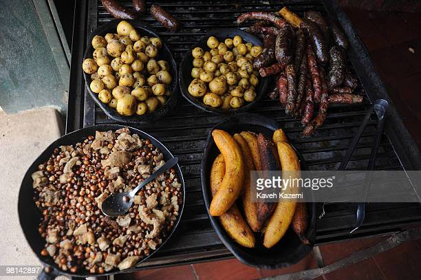 Typical Colombian food sausages small potatoes bananas on grill bar in a city restaurant Villa de Leyva is a colonial town and municipality in the...
