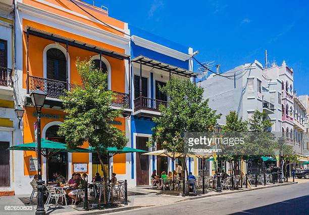 typical colourful houses in recinto sur street - san juan stock pictures, royalty-free photos & images