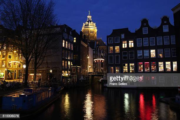 Typical Dutch canal houses and St. Nicholaschurch