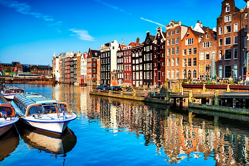 Typical Dutch Houses and Canal in the Center of Amsterdam 509810166