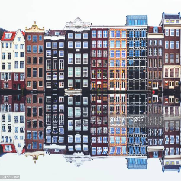 typical dutch houses built by the canal, amsterdam, netherland - dutch culture stock pictures, royalty-free photos & images