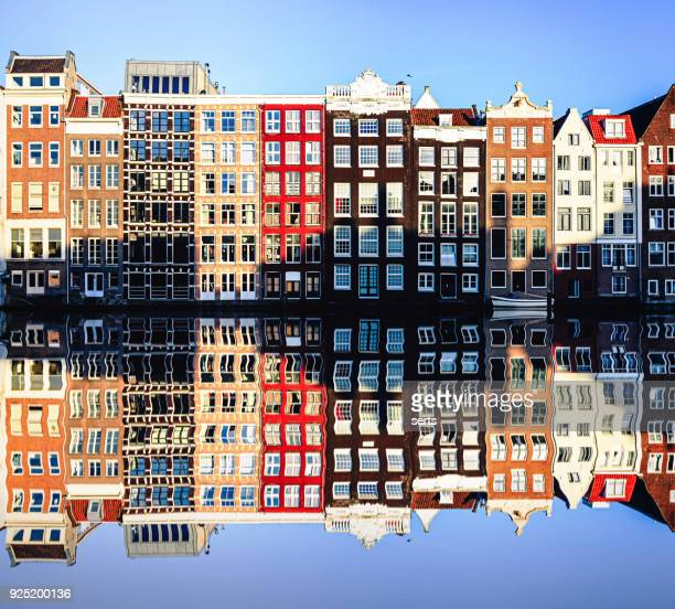 Typical Dutch Houses reflections at night on the water of the canal