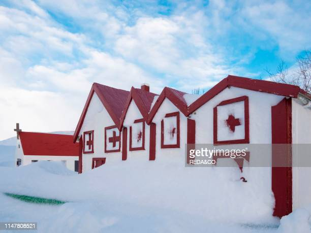 Typical elf houses near a traditional farm near Vik y Myrdal in Island during winter after a heavy blizzard Europe Northern Europe Scandinavia...