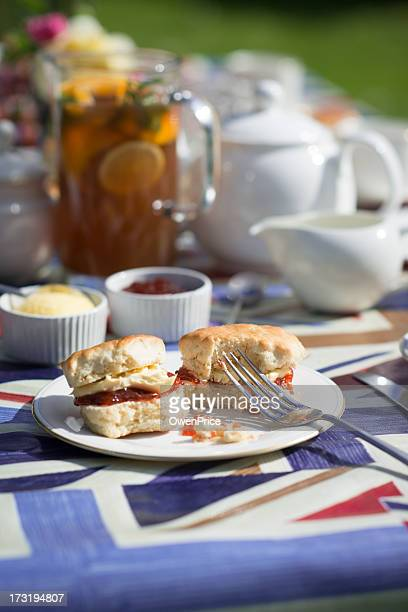 typical english afternoon tea of scone cream and jam - british flag cake stock pictures, royalty-free photos & images