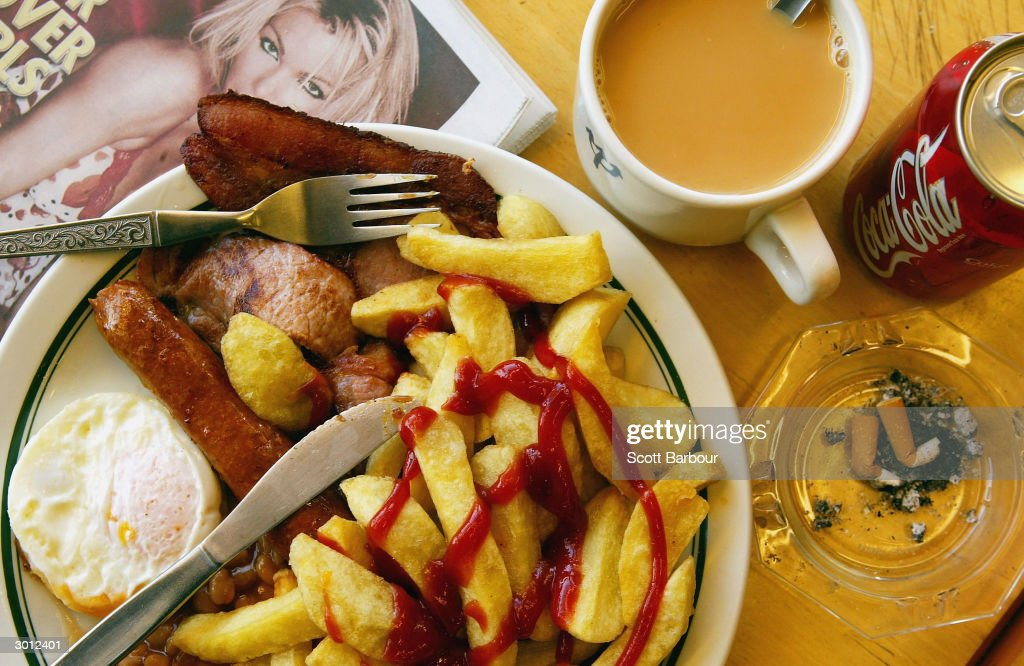 A typical English breakfast of bacon, eggs, sausages and chips sits ready to be eaten at a greasy spoon cafe February 25, 2004 in London. Britain's Treasury adviser Derek Wanless' report on improving the nation's health, 'Securing Good Health for the Whole Population', is expected to focus on the British population's poor diet, lack of exercise, and alcohol abuse.