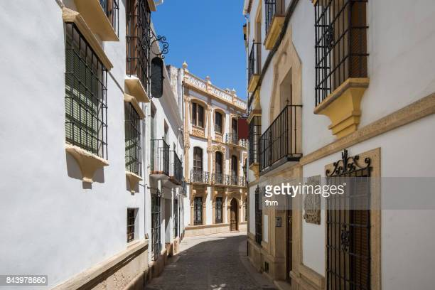 "typical facades and street in a ""white village"" in andalusia (ronda/ andalusia/ spain) - ronda fotografías e imágenes de stock"